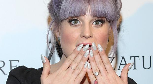 Kelly Osbourne was head-butted by her dog