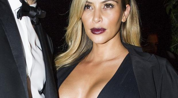 Kim Kardashian showing off her slimmed-down figure at a party in Paris