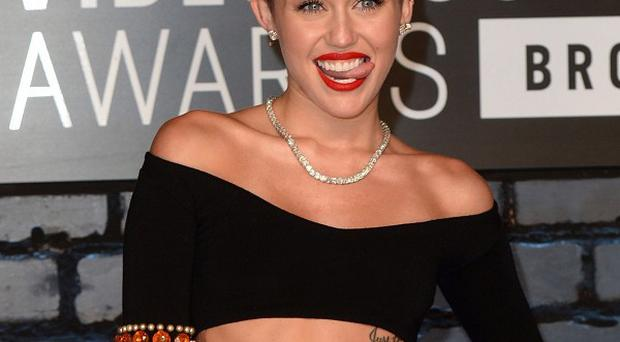 Miley Cyrus says she won't let a break-up spoil her success
