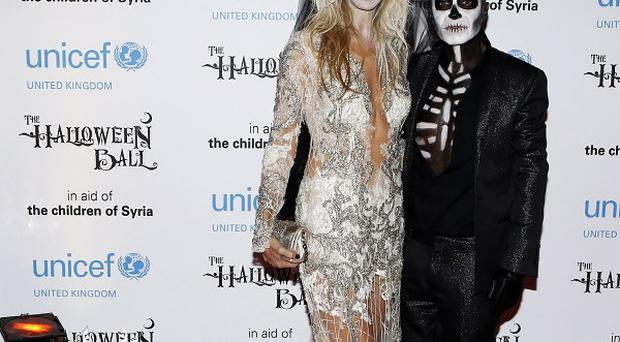 Julien Macdonald and fellow designer Melissa Odabash dressed up for the Unicef Halloween Ball