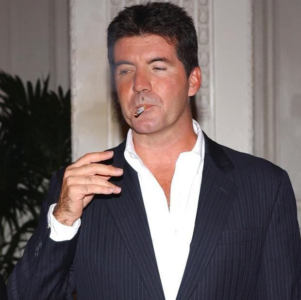 Simon Cowell has pledged to give up smoking
