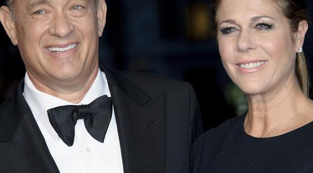 Tom Hanks and Rita Wilson were overcharged for insurance premiums by a man who has now been jailed (AP)