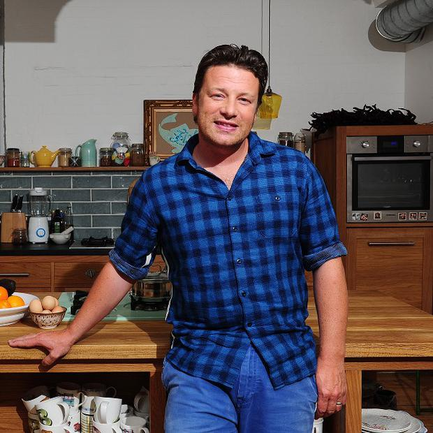 Jamie Oliver has been honoured for his work to improve school dinners