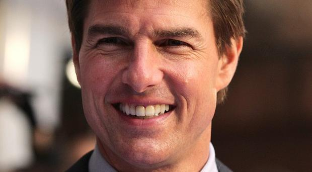 Tom Cruise denied his busy film schedule kept him out of his daughter Suri's life