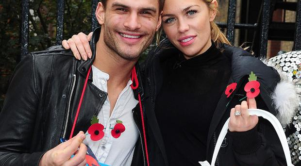 Aljaz Skorjanec and Abbey Clancy selling poppies in Covent Garden
