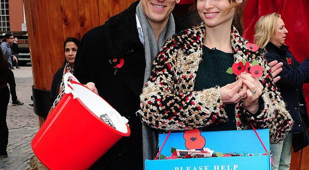 Brendan Cole and Sophie Ellis-Bextor selling poppies in Covent Garden