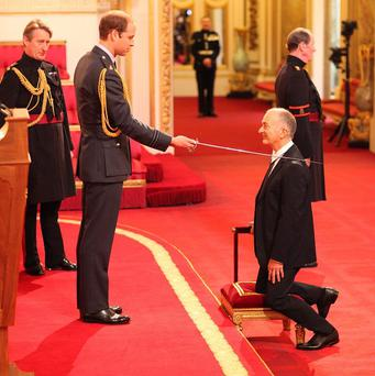 Sir Tony Robinson was knighted by Prince William at Buckingham Palace