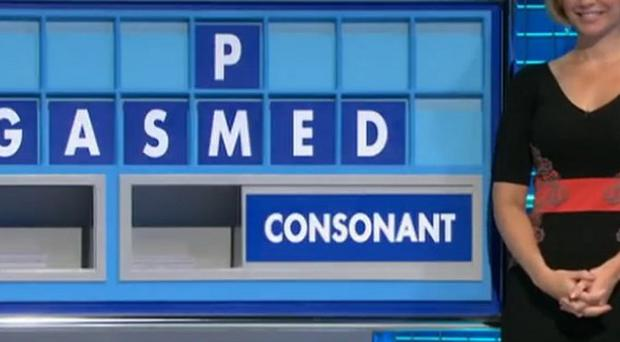 Rachel Riley next to the racy letter board