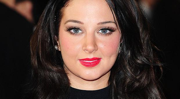 Tulisa Contostavlos has received £42,500 damages from TNT