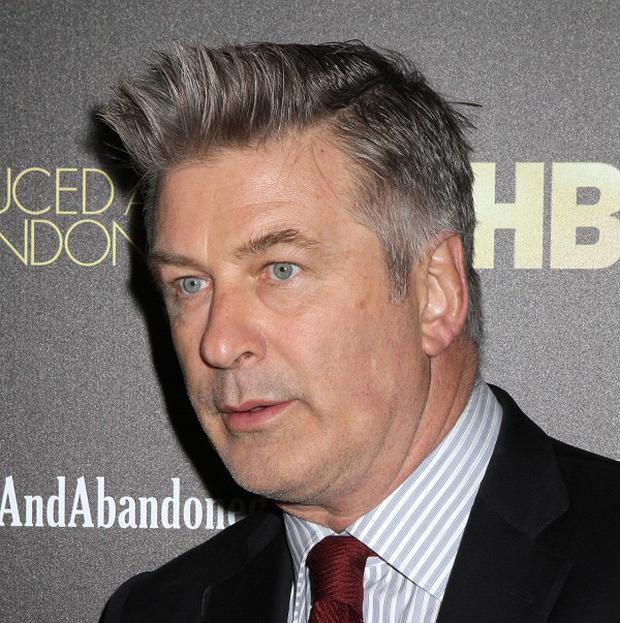 Alec Baldwin's new TV talk show has been suspended for two weeks following remarks the actor and producer made to a reporter (AP)