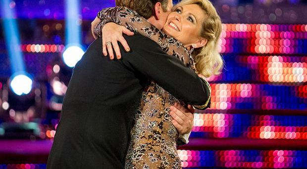 Fiona Fullerton and professional dance partner Anton Du Beke embrace as they leave Strictly Come Dancing