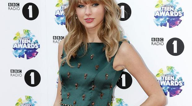 Taylor Swift says she's heard from the ex that her album Red was written about