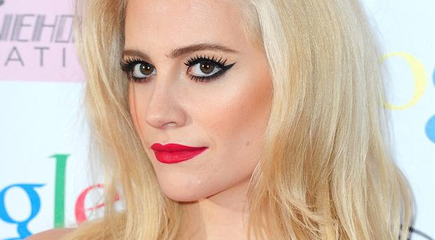 Pixie Lott matched her red lips to her floor-length red Alice Temperley gown for the event