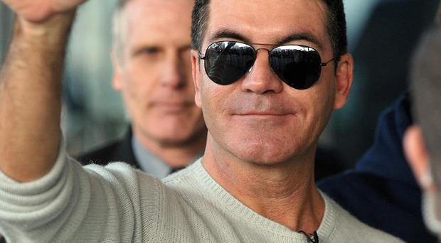Simon Cowell says he will come back to The X Factor UK