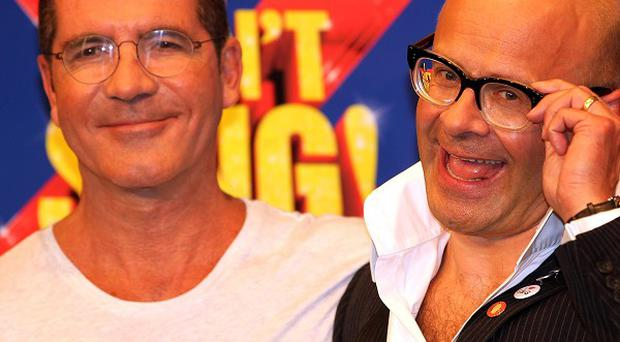 Harry Hill says he isn't afraid to add a Simon Cowell baby joke into his X Factor musical
