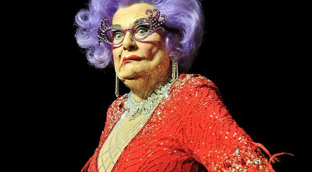 The Prince of Wales and Duchess of Cornwall were surprised to find Dame Edna Everage in the royal box