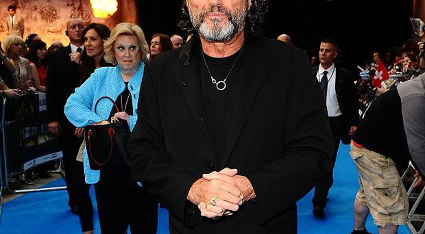 Ian McShane says he helps out pal John Hurt with technology