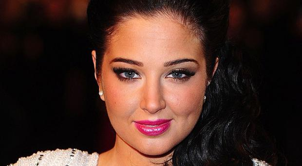 Tulisa Contostavlos has been interviewed about allegedly assaulting a blogger