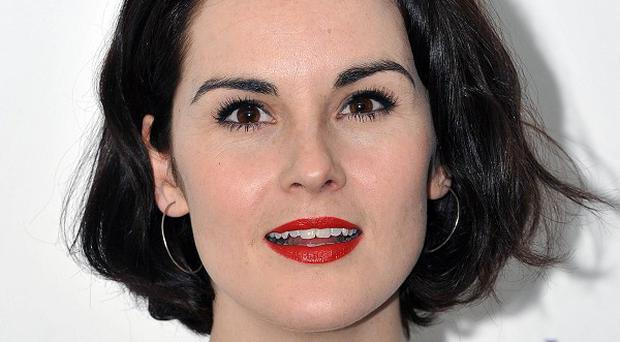 Michelle Dockery attends the Downton Abbey themed fundraiser for the NSPCC at The Savoy Hotel, Strand, London.