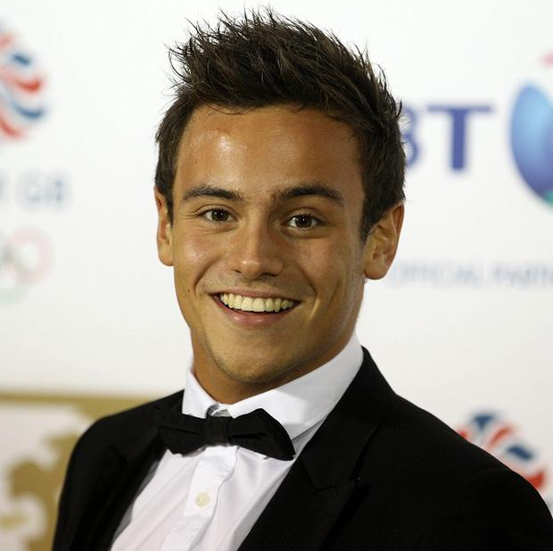 Tom Daley is in a relationship with a man