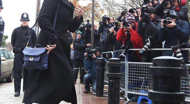 Nigella Lawson faced dozens of photographers and TV crews when she arrived at court