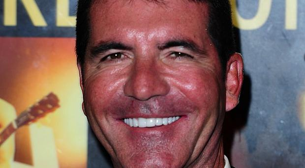 Simon Cowell commented on Russell Brand's political opinions