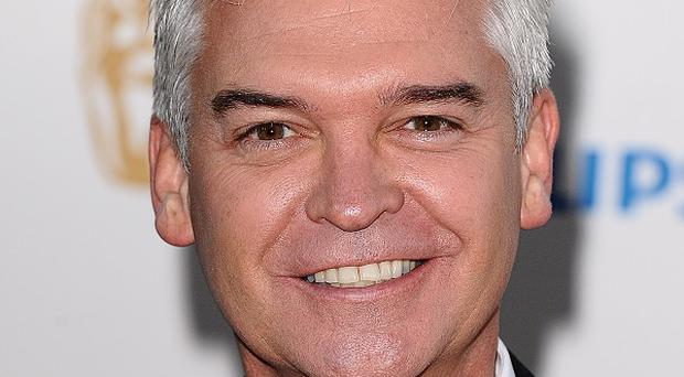 Phillip Schofield hosts Dancing On Ice with Christine Bleakley