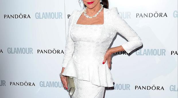 Joan Collins doesn't see herself as a grandmother