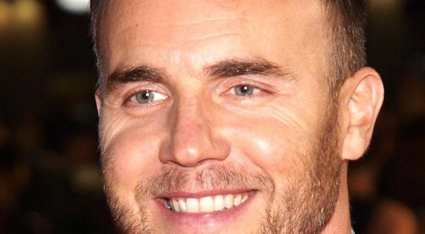 Gary Barlow visited Afghanistan and sang with a band of military personnel for a TV show