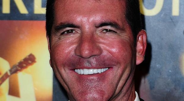 Simon Cowell will apparently be spending Christmas with Sinitta