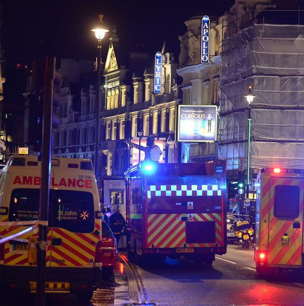 Emergency services at the scene at the Apollo Theatre in Shaftesbury Avenue, central London