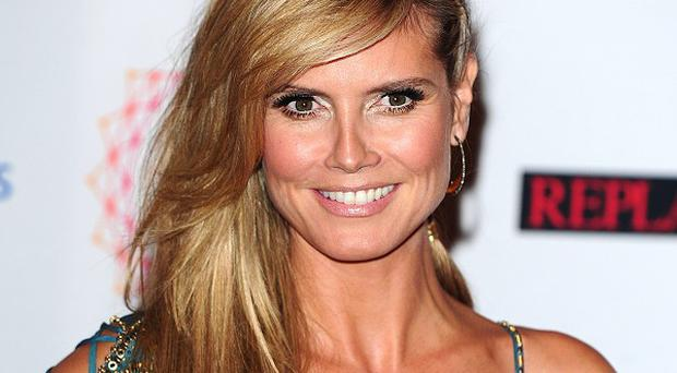 Model Heidi Klum is a mother of four