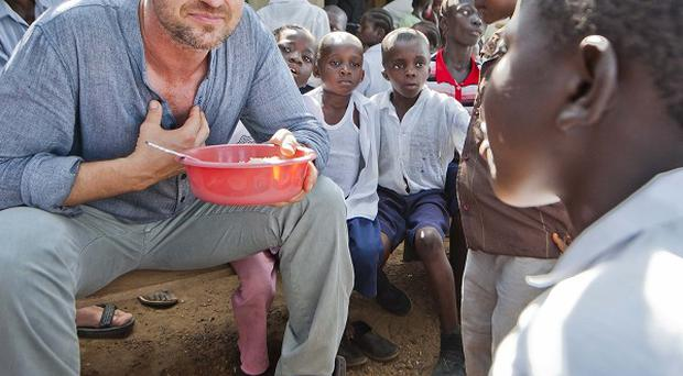 Gerard Butler has swapped filming for charity work in Liberia