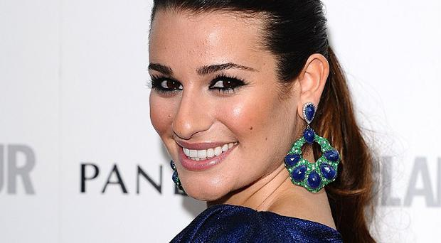 Lea Michele tweeted a photo of herself relaxing by a fireplace