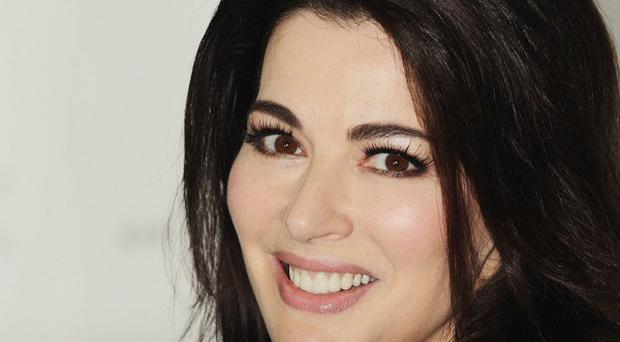 Nigella Lawson says she is not a fan of conflict, and uses food to bring harmony to situations