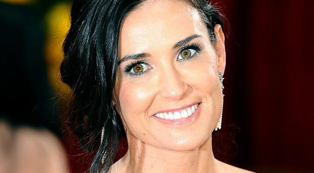 Demi Moore has been pictures on holiday with a new man