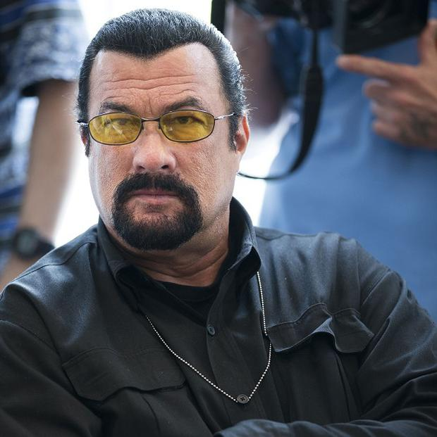 "Steven Seagal said Putin's ""desire to protect the Russian-speaking people of Crimea, his assets, and the military base in Sevastopol … is very reasonable."""