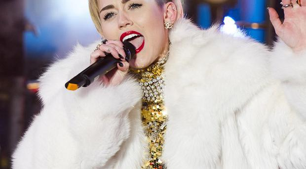 Miley Cyrus is promoting Marc Jacobs' fashion line