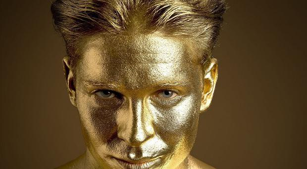 Joey Essex is painted gold in a promotion for PizzaExpress to celebrate 45 years since the firm started producing its doughballs (PizzaExpress/PA)