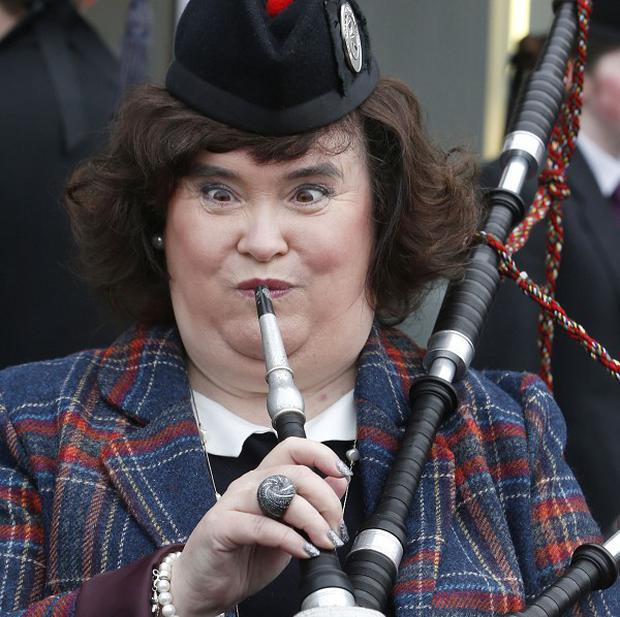 Susan Boyle tries out the bagpipes