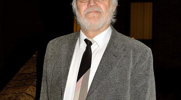 Former Radio 1 DJ Dave Lee Travis denies 13 counts of indecent assault and one count of sexual assault