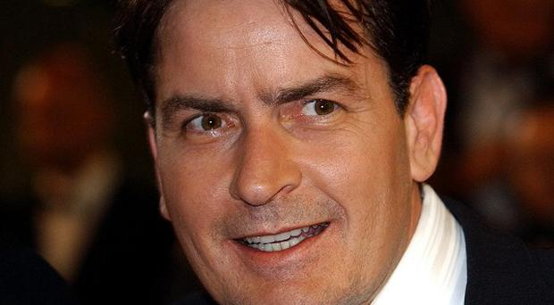 Charlie Sheen apologised for criticising Ashton Kutcher