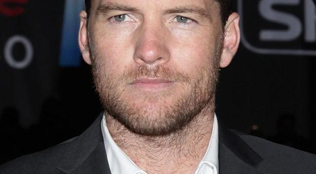 Sam Worthington has been arrested for punching a photographer