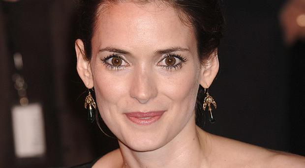 Winona Ryder says Dame Helen Mirren helps her out with DIY