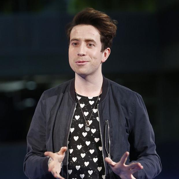 "Nick Grimshaw told listeners that he had swallowed ""something weird"""