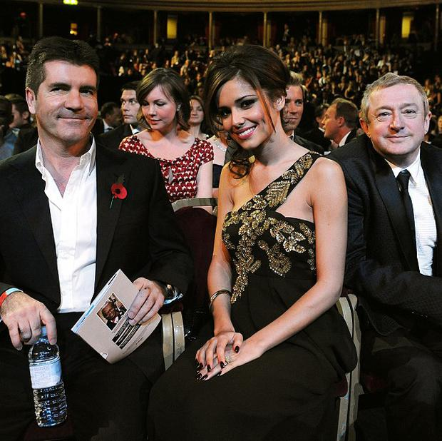 Simon Cowell and Cheryl Cole are reportedly at war over who will join them on the judging panel when The X Factor makes its return later this year