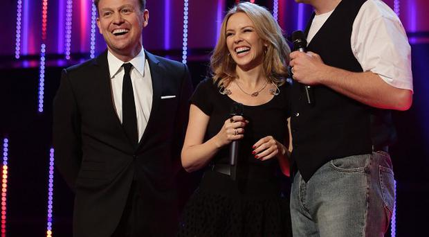 Jason Donovan, Kylie Minogue and David Walliams on stage for BBC Sport Relief 2014 (PA/BBC)