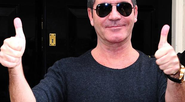 Simon Cowell has been advised to 'get his hands dirty' in terms of looking after his baby son