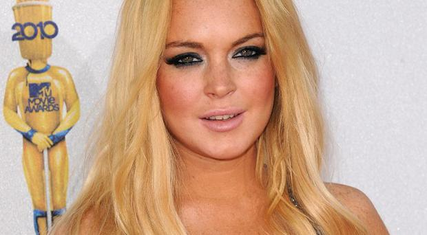 Lindsay Lohan says she has come close to drinking again