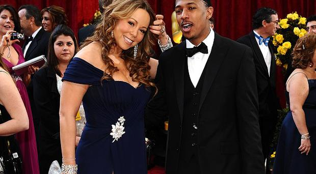 Nick Cannon has laughed off rumours that wife Mariah Carey cheated on him